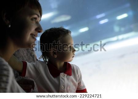 Family studying marine life at a big aquarium - stock photo