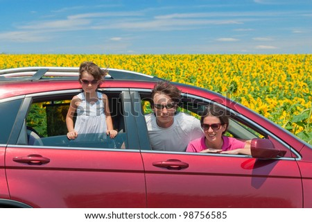 Family summer vacation, travel by car. Happy active parents with child having fun in car trip, looking at beautiful nature - stock photo