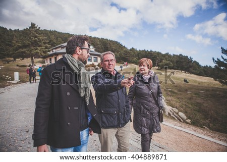 Family taking a walk in the mountain