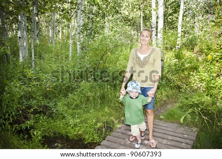 Family taking a walk in the woods together