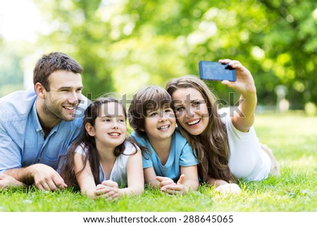 Family taking photo of themselves