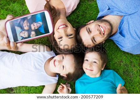 Family taking picture of themselves - stock photo