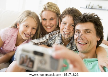 Family taking self portrait with digital camera - stock photo