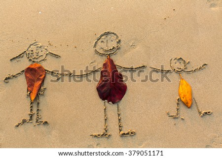 Family, three people drawn on the beach sand. - stock photo