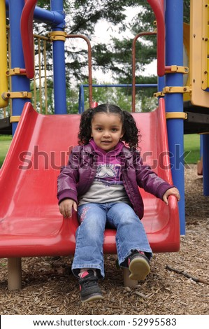 Family time at Jungle Gym playground - stock photo