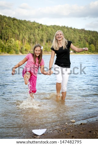 Family time by the lake in summer time - stock photo