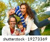 family time - playful family in the park - stock photo