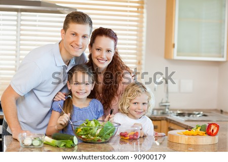 Family together in the kitchen - stock photo
