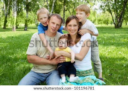 Family together in the summer park with children