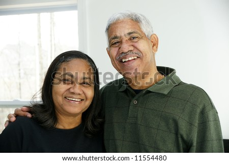 Family together inside their home - stock photo