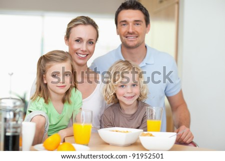 Family together with healthy breakfast - stock photo
