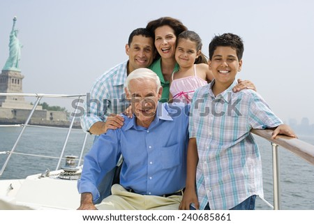 Family Touring New York Near Statue of Liberty National Monument - stock photo