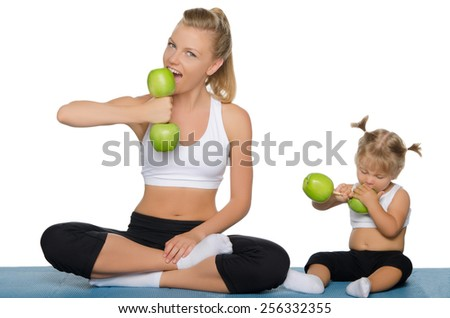 Family trains the weights of green apples isolated on white