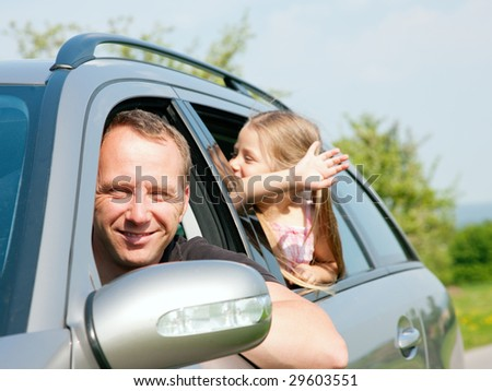 Family travelling by car - stock photo