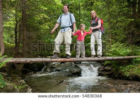 Family trekking - stock photo