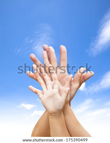 family united hands with blue sky and cloud  - stock photo