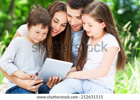 Family using digital tablet  - stock photo
