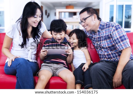 Family using digital tablet browsing the internet - stock photo