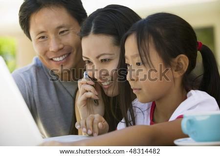 Family Using Laptop - stock photo