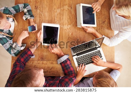 Family using new technology, overhead view - stock photo