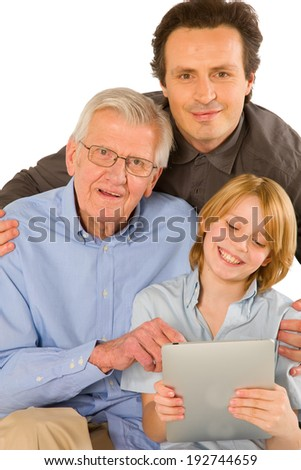 family using pc tablet - stock photo