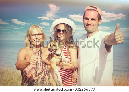 family vacation by the sea - stock photo