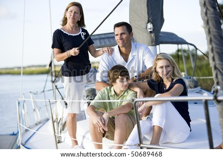 Family vacation together on sailboat, on Florida intracoastal waterway - stock photo