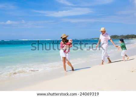 Family vacation. Young family of four in tropical paradise - stock photo