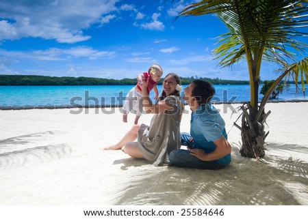 Family vacation. Young family of three on vacation. Taken with wide angle lens. - stock photo