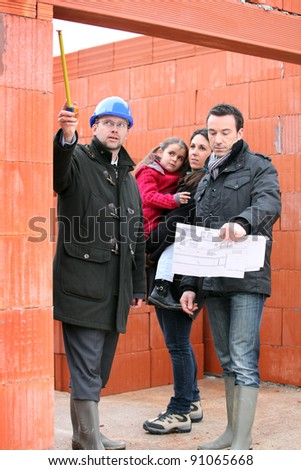 family visiting their future house - stock photo