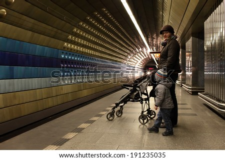 Family waiting a train at subway station in Prague - stock photo