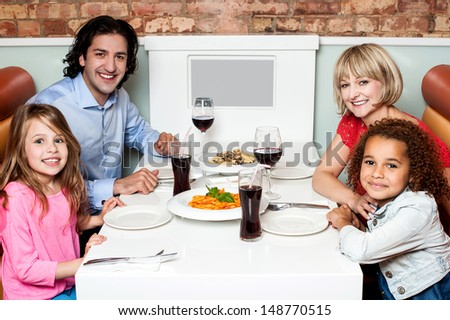 Family waiting for the lunch, they ordered - stock photo