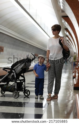 Family waiting train on the platform station - stock photo
