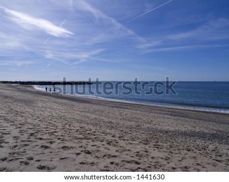 Family waking af walk at the north-sea coast, Jutland, Denmark - stock photo