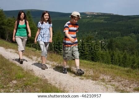 Family walking - stock photo