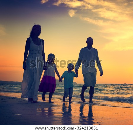 Family Walking Beach Sunset Travel Holiday Concept - stock photo