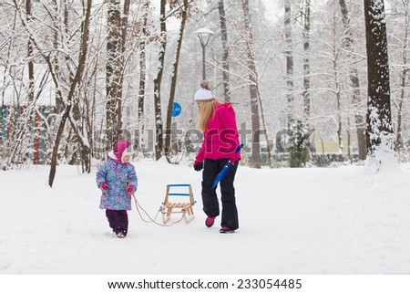 Family walking in a winter park - stock photo
