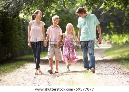 Family Walking In Countryside Together - stock photo