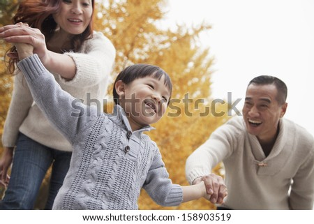 Family walking in park - stock photo