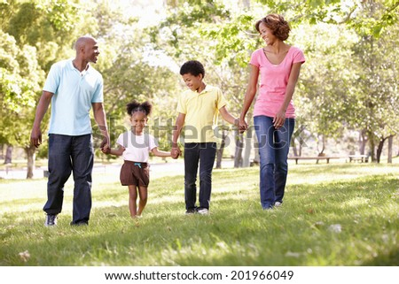 Family walking in park