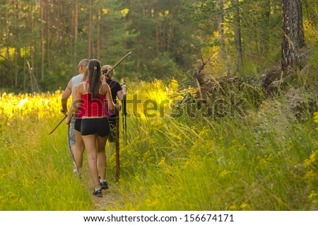 Family walking in the nature on sunny spring day. - stock photo