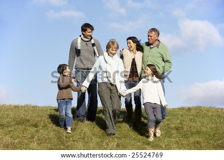 Family Walking In The Park - stock photo