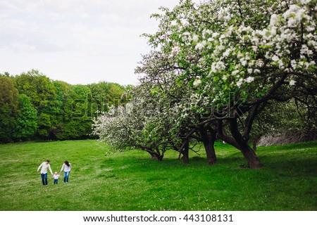 Family walking outdoors - stock photo