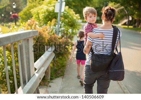 Family walking outside on a bridge