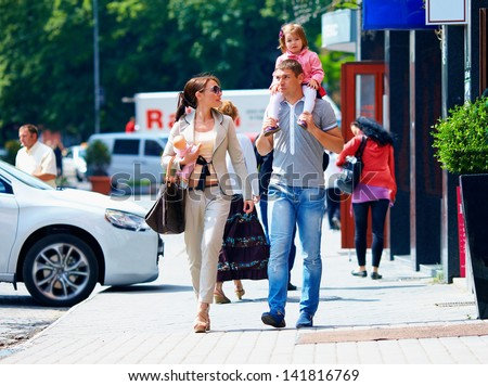 family walking the city street, casual lifestyle - stock photo