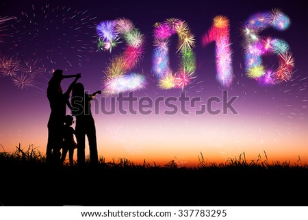 family watching fireworks and happy new year 2016 concept - stock photo