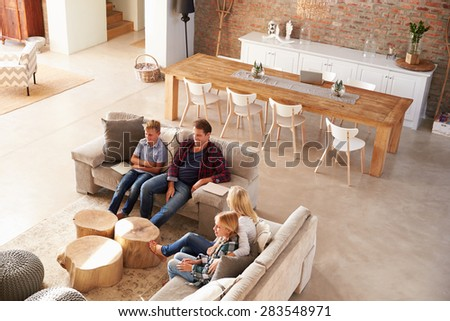 Family watching TV together - stock photo