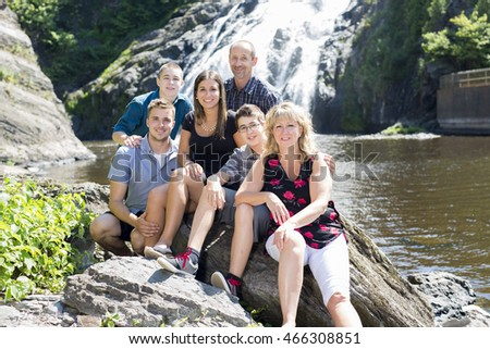 family waterfall having great time