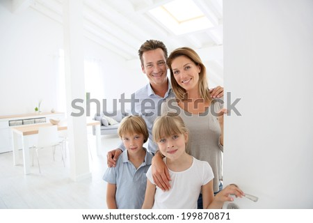 Family welcoming people at entrance door - stock photo