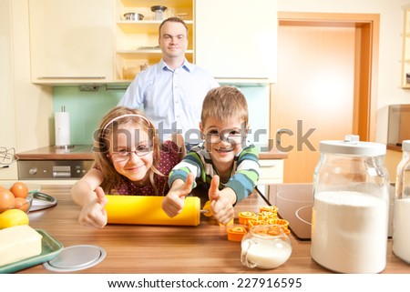 Family when baking with thumbs up